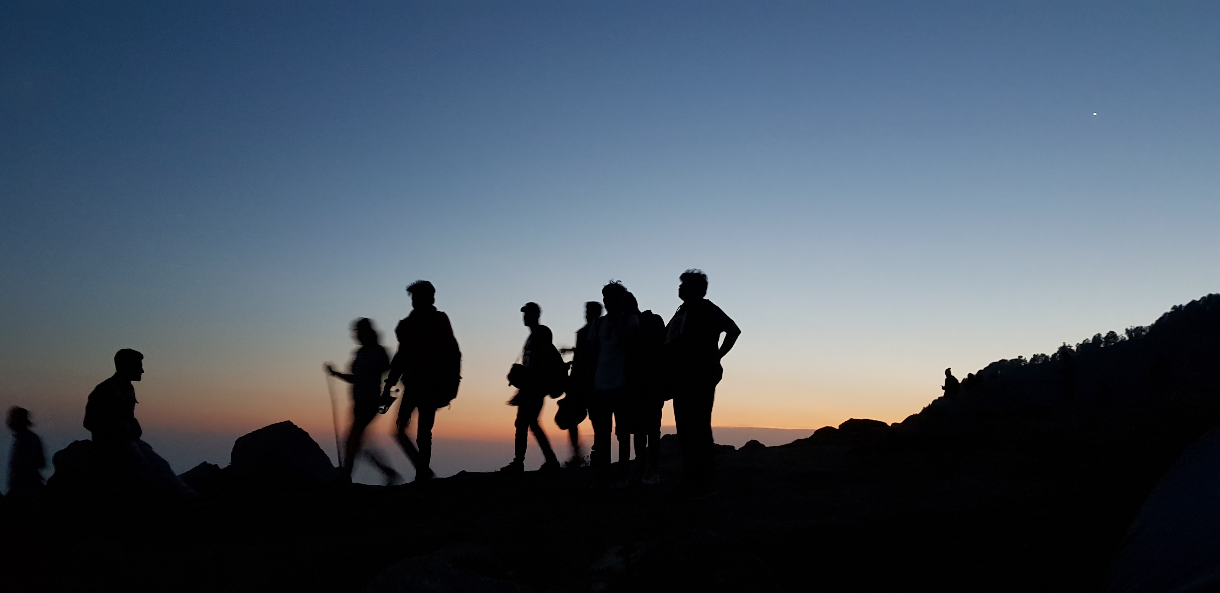 Group of people hiking at dawn